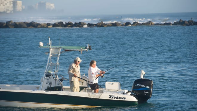 Anglers fish at sunrise Friday, Sept. 1, 2017, the first day of snook season, at the Fort Pierce jetty. During snook season, which runs from Sept. 1 through Dec. 14, fishermen can catch and keep one snook per day that measures 28 to 32 inches. Snook are saltwater fish, but can also be found in Lake Okeechobee, the Kissimmee River and parts of the St. Johns River.