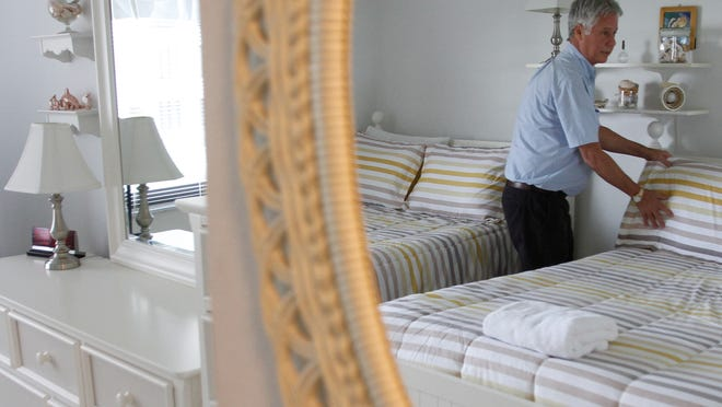Lahaina Island Accommodations Operations Manager John Rush makes sure the pillows are fluffed, stemware is crystal clear and all the light bulbs work before the arrival of monthly renters at the Sandarac condominiums on Fort Myers Beach Wednesday.