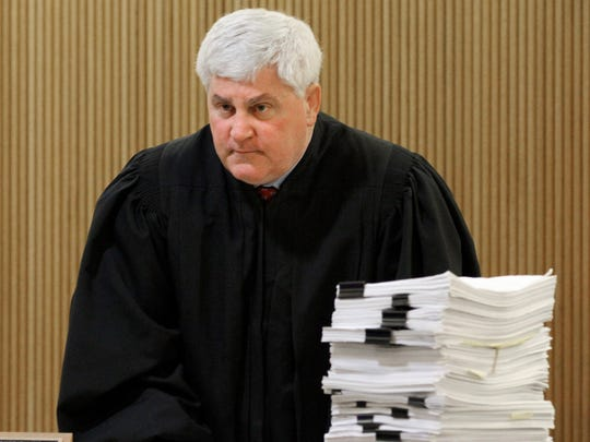 A stack of motions sit on the bench as Superior Court