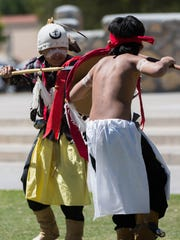 Malakai Chissay, 10, left, and Leondre Antonio, 10, right, perform the War Dance as part of the celebration of American Indian Week at New Mexico State University.  Native American dance group Cibeque Apache Crown Dancers and other performed at the Corbett Center Outdoor Stage, Wednesday, April 5,2017.