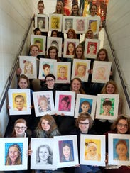 Merrill High School art students made portraits of
