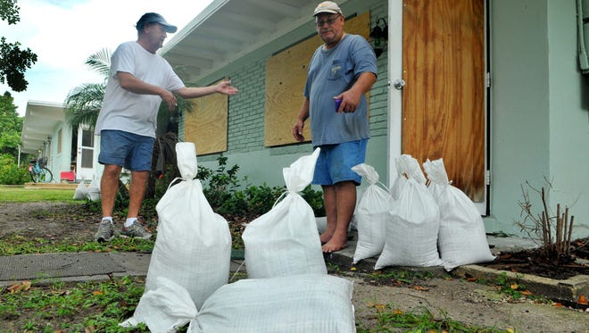 Oct 6, 2016; Brevard, FL, USA; Craig Sutton and Steve Taylor of Cape Canaveral get ready to sandbag apartments in preparation for Hurricane Matthew to make landfall. Mandatory Credit: Craig Rubadoux/Florida Today via USA TODAY NETWORK