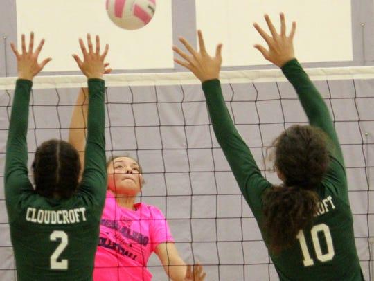 Mescalero's Alyn Kazhe-Kirgan, center, hits a ball