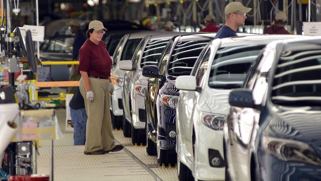 A worker at the Toyota plant near Tupelo oversees the line in 2012.
