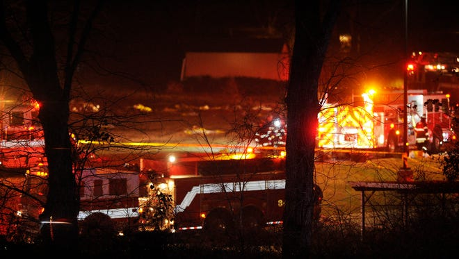 Fire crews work the scene of a plane that crashed near the YMCA in Bellevue, Tenn., on Monday, Feb. 3, 2014.