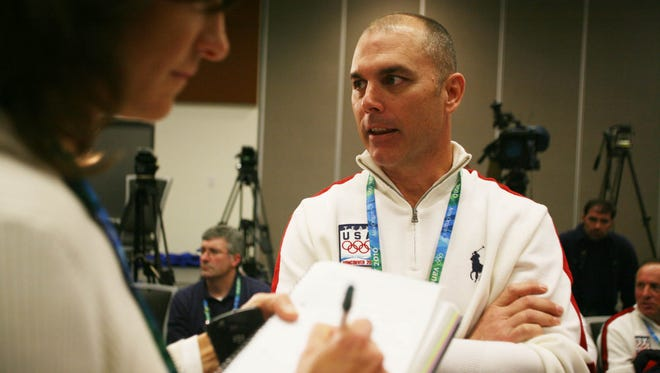 USA bobsled coach Brian Shimer speaks with a reporter following a news conference with the men's team during the Vancouver 2010 Winter Olympics.