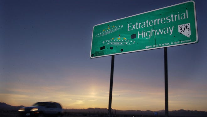 A car moves along the Extraterrestrial Highway near Rachel, Nev.