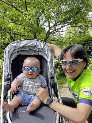 Dario Palmieri is pictured with his son, Leonardo. Palmieri and his wife, Anna Tessari, have seen the benefits of Pelotonia fundraising firsthand. The Upper Arlington residents both work in the Ohio State University College of Medicine Department of Cancer Biology and Genetics..