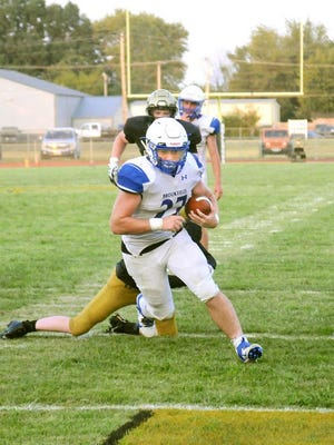 """Senior fullback Trace Alexander of the Brookfield Bulldogs had three scoring runs, including this one, and over 100 rushing yards in BHS' season-opening victory at Trenton Friday, Aug. 28, 2020. This Friday, he'll try to help his team keep possession of """"the bell"""" prize from Brookfield's rivalry duel with Linn County neighbor Marceline."""