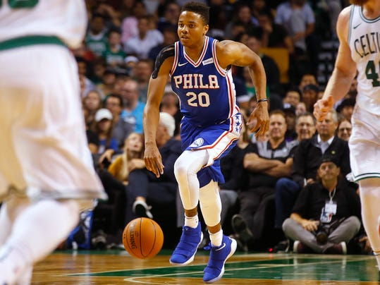 FILE - In this Oct. 9, 2017, file photo, Philadelphia 76ers guard Markelle Fultz dribbles during the first quarter of a preseason NBA basketball game against the Boston Celtics in Boston. Fultz, the top overall pick in last year's NBA draft, may not play again this season as he deals with a right shoulder injury. Fultz played the 76ers' first four games of the season but has been sidelined since. Sixers president of basketball operations Bryan Colangelo said Friday, Feb. 9, 2018, before the team plays the New Orleans Pelicans that Fultz is progressing in his recovery but with uncertainty. (AP Photo/Winslow Townson, File)