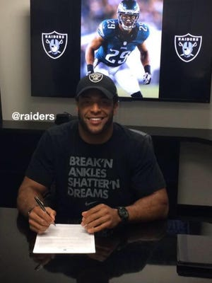 Nate Allen, an NFL safety and Cape Coral High School graduate, signs his new contract with the Oakland Raiders.