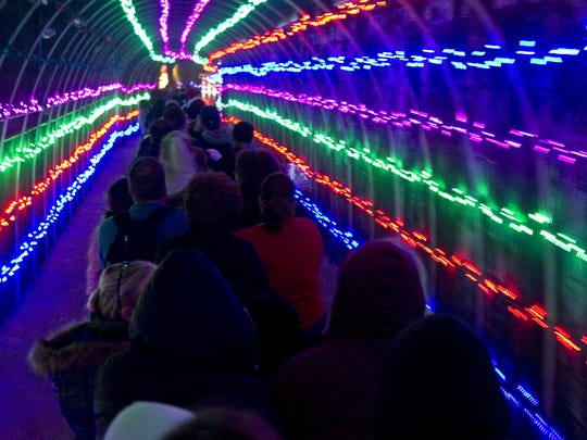 The train takes riders through a lighted tunnel during the  McCormick-Stillman Railroad Park Holiday Lights in Scottsdale in 2012.