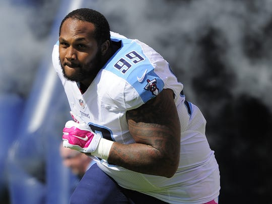 Titans defensive end Jurrell Casey (99) runs through the tunnel and out onto the field for the game against Buffalo at Nissan Stadium on Oct. 11, 2015.