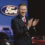Alan Mulally will retire as Ford CEO and president on July 1 and Mark Fields will replace him. The company announced the transition Thursday May 1, 2014 at a press conference at its headquarters in Dearborn attended by hundreds of employees along with Mulally, left, Ford Executive Chairman Bill Ford. Mandi Wright/Detroit Free Press