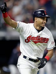 Cleveland's Oscar Mercado celebrates a walk-off single in the 10th inning against Cincinnati on June 11.