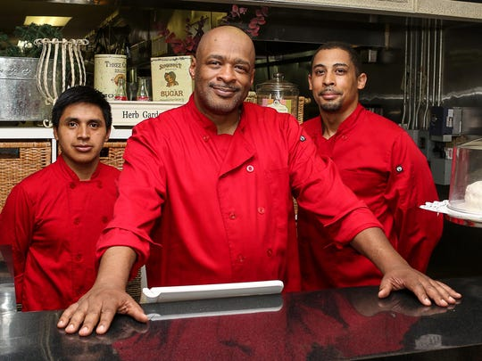 Martin Little, owner of Martin's Southern Cuisine on Speedwell Avenue in Morris Plains, flanked by his two sous chefs, Manuel Vasquez (left) and Nolan Davis (right).