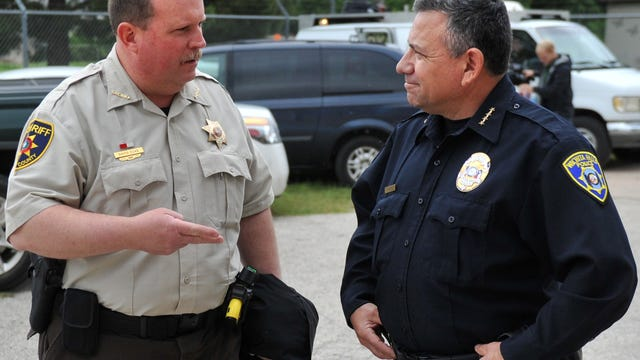 Wichita County Sheriff David Duke (left) and Wichita Falls Police Chief Manuel Borrego talk in the parking lot of the Wichita County Emergency Management. Duke and the Wichita County Commissioners had a discussion Monday about the call for resignation of Florida's Broward County Sheriff Scott Israel.