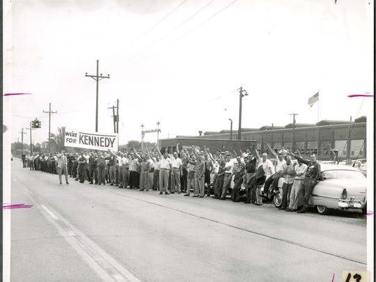 Warner Gear workers wait for presidential candidate John F. Kennedy in 1960.