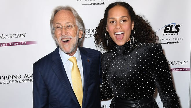 Recording Academy president/CEO Neil Portnow, left, and Alicia Keys at a pre-Grammys event in New York Jan. 25.
