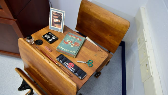 A desk from Mary B. Sharpe Elementary School, from 1908 is pictured. Historian Joan Bowen has moved all of the Chambersburg Area School District memorabilia to the district's annex building at the former Army Reserve Center on Sixth Street.