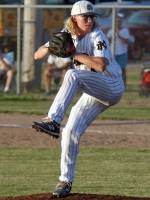 Notre Dame Nike's pitcher Jeron Conner hurls the ball from the mound Tuesday in Wapello.