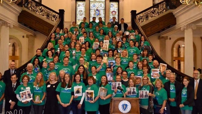 The group gathers at the Massachusetts State House at the conclusion of the PANDAS/PANS Awareness Day in 2019.