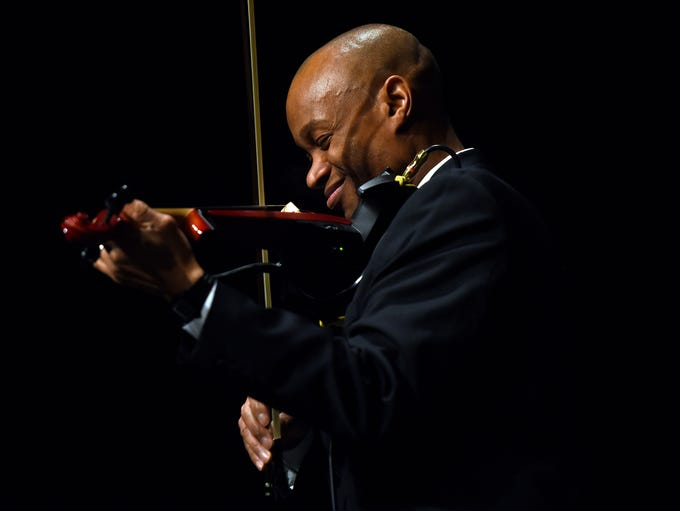 Conductor Rodney Page performs a violin solo during