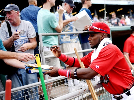 Lansing Lugnuts' Chavez Young sings autographs for fans before the Midwest League All-Star game on Tuesday, June 19, 2018, at Cooley Law School Stadium in Lansing.