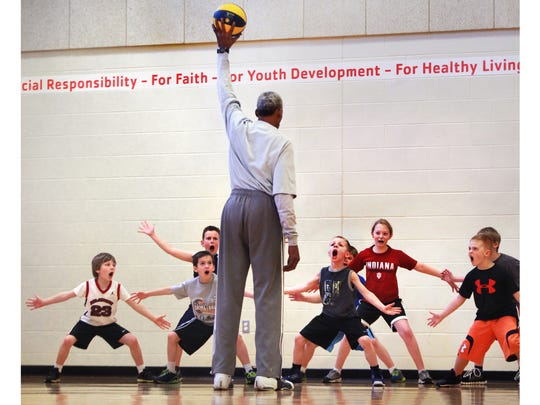 Darnell Hillman coaches kids at a two-day camp in Avon.