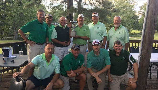 Members of Green Hill pose for a picture after winning the 34th annual City Golf Championship last year.