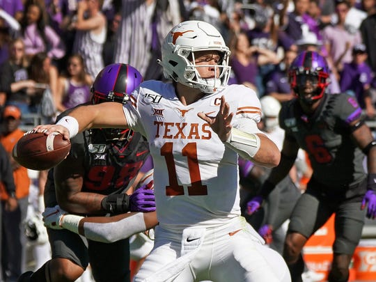 Texas quarterback Sam Ehlinger (11) throws a pass in the first half of an NCAA college football game against TCU in Fort Worth, Texas, Saturday, Oct. 26, 2019. (AP Photo/Louis DeLuca)