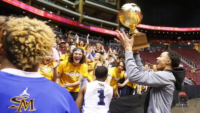 Shadow Mountain Jaelen House (2) celebrated winning  the high school boys basketball: 4A Conference state championship game Salpointe at Gila River Arena in Glendale on February 25, 2017. House was ejected from the game during a skirmish with Salpointe Isaac Cruz (3)and was not allowed on the court to celebrate with his team.