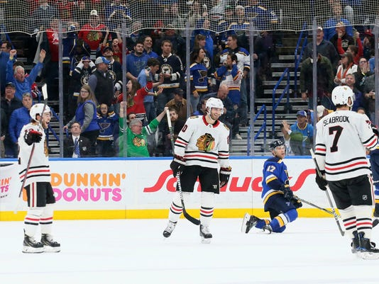 Chicago Blackhawks defenseman Duncan Keith (2) is congratulated by teammates after he scored past St. Louis Blues goaltender Jake Allen, left, in the final seconds of an NHL hockey game Wednesday, April 4, 2018, in St. Louis. (Chris Lee/St. Louis Post-Dispatch via AP)