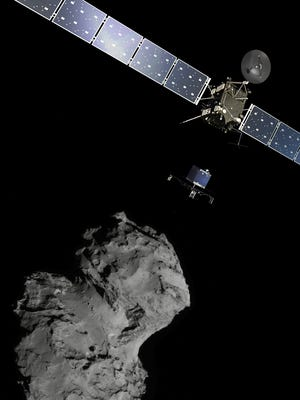The picture released by the European Space Agency ESA shows the Rosetta mission poster which is a combination of various images to illustrate the deployment of the Philae lander to comet 67P/Churyumov–Gerasimenko. from the Rosetta spacecraft.  The image of the comet was taken with the navigation camera on Rosetta. On Wednesday, Nov. 12,  2014 the Philae lander will be detached from Rosetta to land on the comet. (AP Photo/ESA)