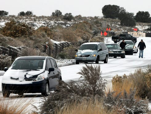 Cars slide on Paseo del Norte Sunday, in Albuquerque, N.M., after a winter storm hit New Mexico over the weekend making driving difficult for drivers.