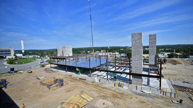 Progress continues on the new Veterans Administration clinic Tuesday on the campus of University of Massachusetts Medical School.