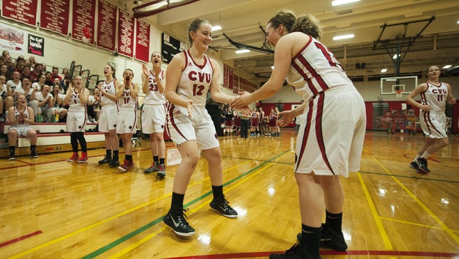 CVU's Emma Hess (12) takes the court for the starting lineup introductions before the girls basketball game between Spaulding and Champlain Valley Union on Thursday night.