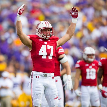 Badgers linebacker Vince Biegel fires up the crowd against LSU at Lambeau Field Sept. 3.