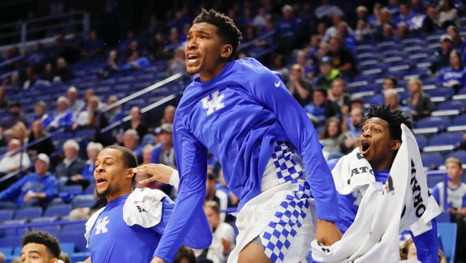 Kentucky Wildcats guard Malik Monk (5) guard De'Aaron Fox (0) and guard Isaiah Briscoe (13) celebrate on the sideline during the game against the Asbury Eagles in the second half at Rupp Arena. Kentucky defeated Asbury 156-63.