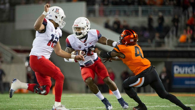 Nov 19, 2016: Arizona Wildcats running back Samajie Grant (10) carries the ball as Oregon State Beavers cornerback Dwayne Williams (4) defends during the second quarter at Reser Stadium.