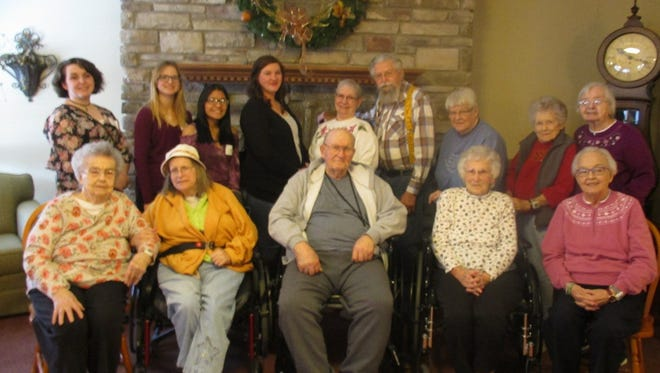 Acorn Hill residents, pictured in the front row from left, Doris Kennedy, Kerry Juvonen, Sonny Igl, Doris Brown and Donna Mueller welcomed students from Mosinee High School, including (back row) Jazmyne Brown, Sarah Buenning, Rosa Contreras and their adviser Natalie Krzanowski, along with Acorn Hill residents Elaine Koss, Dave Coleman, Leona Dahlke, Ardella Thimm and Sophie Pachniak.
