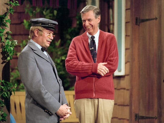 "Fred Rogers (right) and David Newell, as Speedy Delivery's Mr. McFeely, stand on the front porch set while filming an episode of ""Mister Rogers' Neighborhood."""