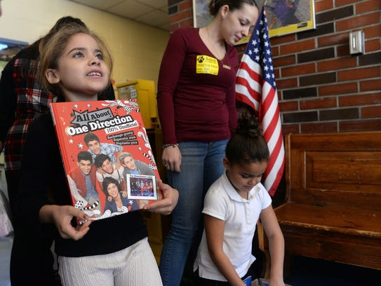 Barse School first grader Leah Echevarria holds up