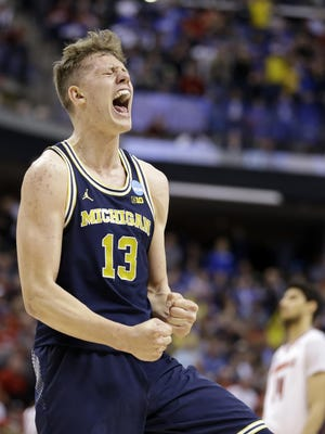 Michigan forward Moritz Wagner (13) celebrates a 73-69 win over Louisville in a second-round game in the men's NCAA college basketball tournament.
