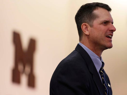 Jim Harbaugh answers questions as the new Michigan