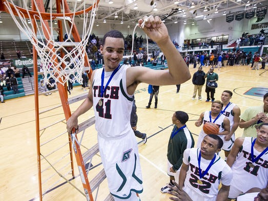 Arsenal Tech High School senior Trey Lyles (41) celebrates winning the 2014 Indianapolis City Boys Basketball Tournament at Arsenal Technical High School Thursday, Jan. 30, 2014. Arsenal Tech defeated Cathedral 66-58.