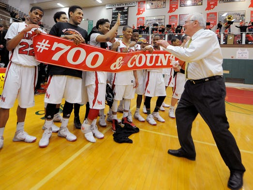 Lawrence North head coach Jack Keefer celebrates his 700th victory with his team after the game against Center Grove, Friday, January 31, 2014, in Indianapolis. Keefer won his 700th game with a 83-35 victor over Center Grove.