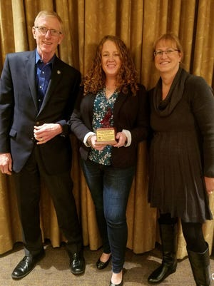 Larry Fletcher, Amanda Smith Rasnick and Dawn Weinhardt, of Lake Erie Shores & Islands, celebrate numerous awards at the Ohio Travel Association's Conference on Travel in Akron last week.