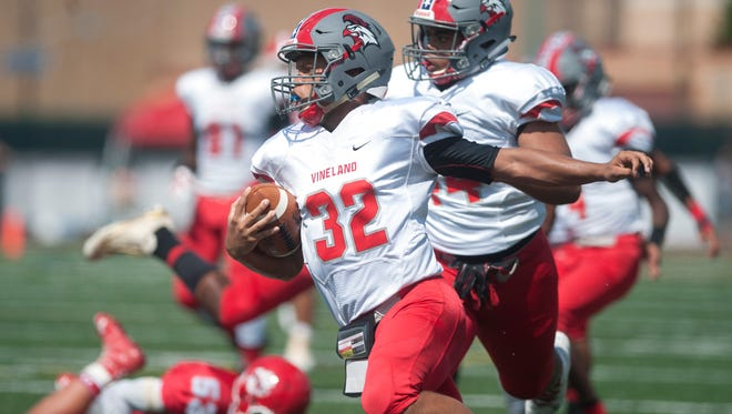 Vineland's Javier Santana runs the ball after catching an interception during the 4th quarter of Saturday's football game between Vineland and Cherry Hill East, played at Cherry Hill East High School.  Vineland won 61-6.