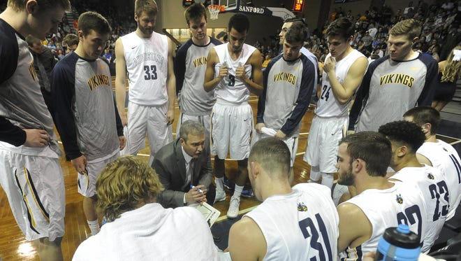 Augustana's head coach Tom Billeter speaks with the team during a timeout earlier this season. The Vikings are set for their biggest test yet Saturday in the championship game.